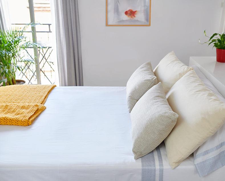 Detalle sábanas y cojines